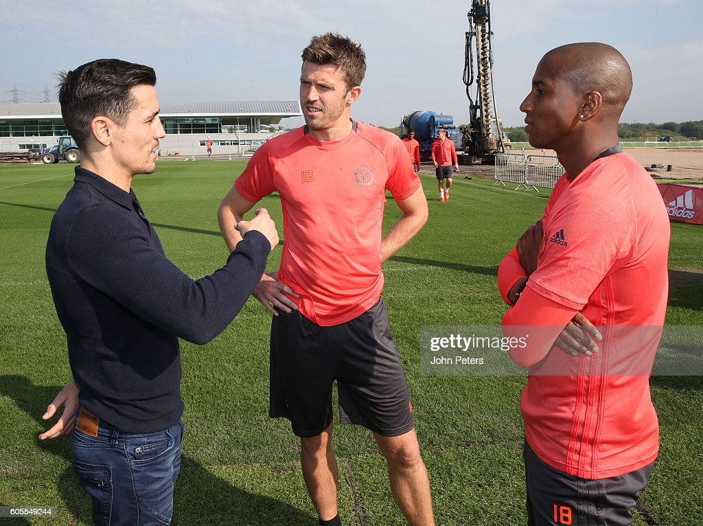 Boxer Anthony Crolla chats to Ashley Young (R) and Michael Carrick of Manchester United during a Manchester United training session at Aon Training Complex on September 14, 2016 in Manchester, England.