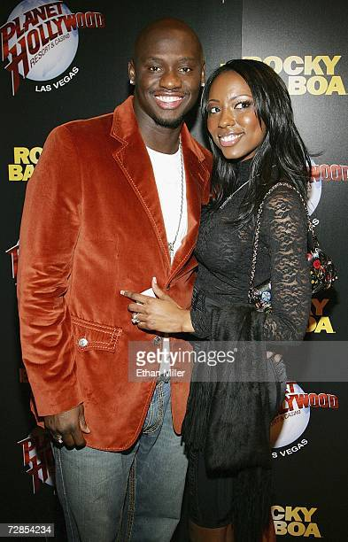 Boxer Antonio Tarver and his fiancee Denise Boothe pose as they arrive at a party following the Las Vegas premiere of the movie Rocky Balboa at the...