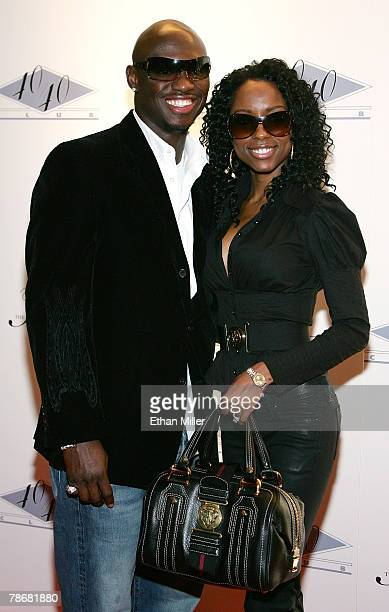 Boxer Antonio Tarver and his wife Denise Tarver arrive at the opening of JayZ's USD 20 million 40/40 Club a 24000squarefoot sports bar and lounge at...