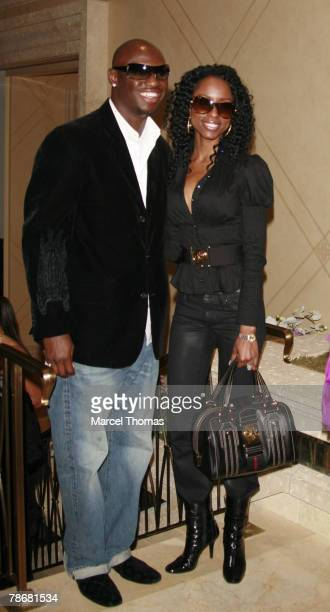 Boxer Antonio Tarver and wife Denise arrives at the Palazzo Hotel for the grand opening of JayZ's 40/40 Club on December 30 2007 in Las Vegas Nevada
