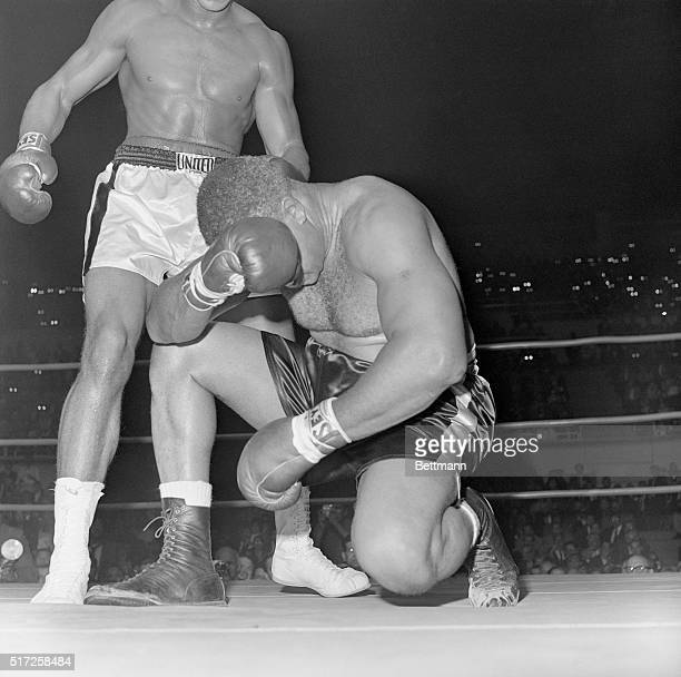 Boxer Archie Moore waits for the count with his head in his hands in the fourth round of a fight with Cassius Clay in 1962. Clay hit Moore twice...
