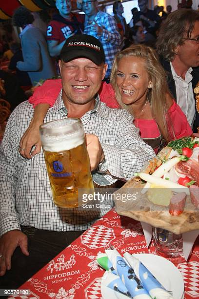 Boxer Axel Schulz and Patricia Reich attend the Berlin Oktoberfest on September 10 2009 in Berlin Germany