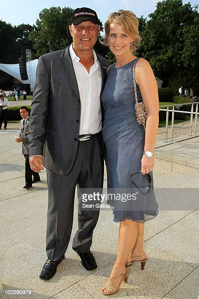 Boxer Axel Schulz and Stefanie Moellenkamp head of the Laureus Sport for Good Foundation in Germany attend the President's annual summer garden party...