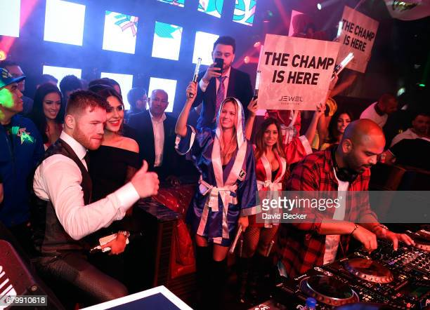 Boxer Canelo Alvarez and Fernanda Gomez celebrate during his afterfight party at Jewel Nightclub at the Aria Resort Casino on May 6 2017 in Las Vegas...