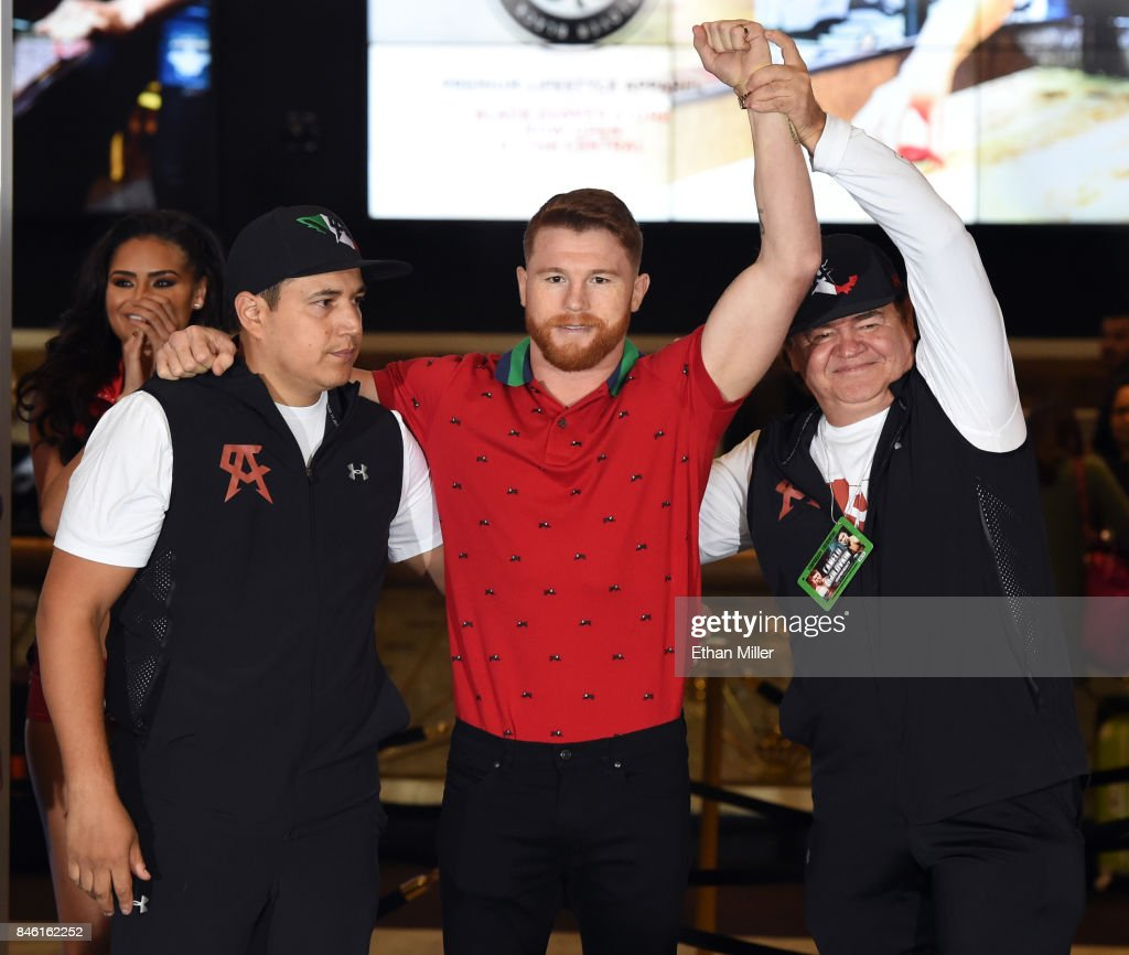 Boxer Canelo Alvarez (C) and his trainer Eddy Reynoso (L) and manager/trainer Jose 'Chepo' Reynoso (R) pose as they arrive at MGM Grand Hotel & Casino on September 12, 2017 in Las Vegas, Nevada. Alvarez will challenge WBC, WBA and IBF middleweight champion Gennady Golovkin for his titles at T-Mobile Arena on September 16 in Las Vegas.
