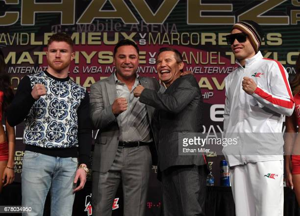 Boxer Canelo Alvarez Chairman and CEO of Golden Boy Promotions Oscar De La Hoya former boxer Julio Cesar Chavez Sr and his son boxer Julio Cesar...