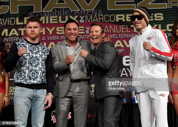 Boxer Canelo Alvarez Golden Boy Promotions Chairman and CEO Oscar De La Hoya former boxer Julio Cesar Chavez Sr and his son boxer Julio Cesar Chavez...