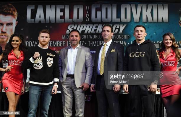 Boxer Canelo Alvarez, Golden Boy Promotions Chairman and CEO Oscar De La Hoya, boxing promoter Tom Loeffler and WBC, WBA and IBF middleweight...