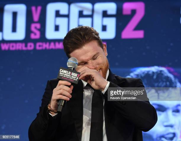 Boxer Canelo Alvarez laughs during a news conference with Gennady Golovkin to announce their rematch during a news conference at Microsoft Theater at...