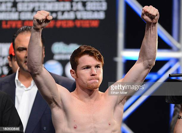 Boxer Canelo Alvarez poses during the official weighin for his bout against Floyd Mayweather Jr at the MGM Grand Garden Arena on September 13 2013 in...