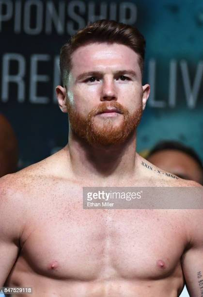 Boxer Canelo Alvarez poses on the scale during his official weighin at MGM Grand Garden Arena on September 15 2017 in Las Vegas Nevada Alvarez will...