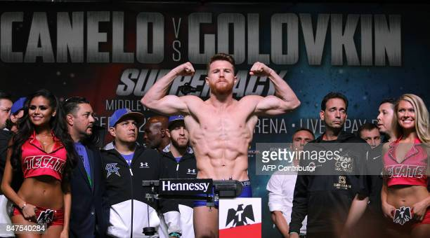 Boxer Canelo Alvarez poses on the scales during a weighin with Gennady Golovkin at the MGM Grand Hotel Casino on September 15 2017 in Las Vegas...