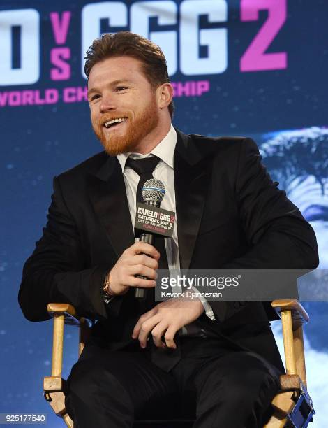 Boxer Canelo Alvarez speaks during a news conference with Gennady Golovkin to announce their rematch during a news conference at Microsoft Theater at...