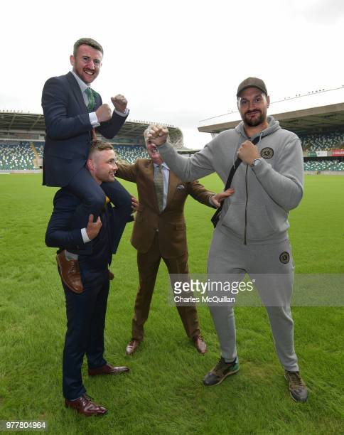 Boxer Carl Frampton gives friend and fellow boxer Paddy Barnes a leg up as he goes toe to toe with Tyson Fury watched by promoter Frank Warren as...