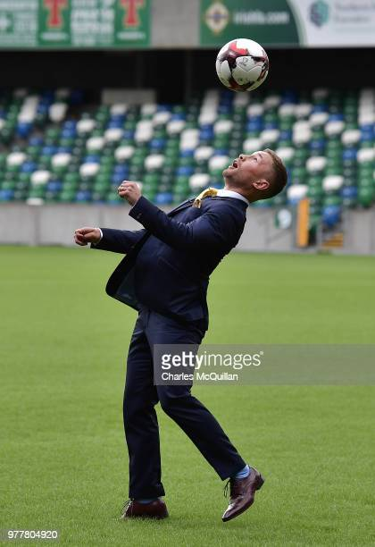 Boxer Carl Frampton plays keep up with a football as he attends a photo call at Windsor Park on June 18 2018 in Belfast Northern Ireland The three...