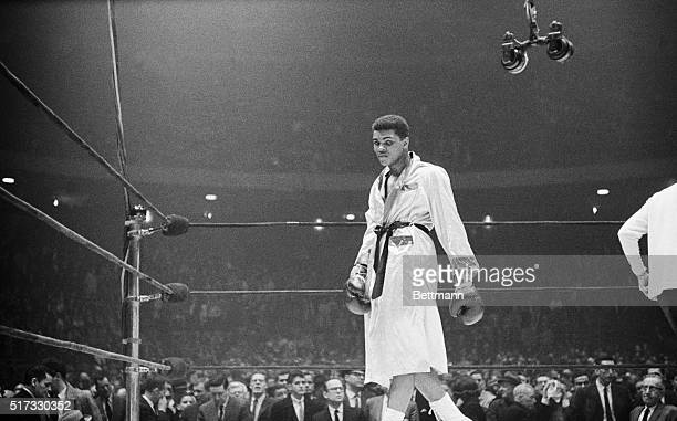 Boxer Cassius Clay paces the ring after the crowd boos his win in a 1963 bout with Doug Jones