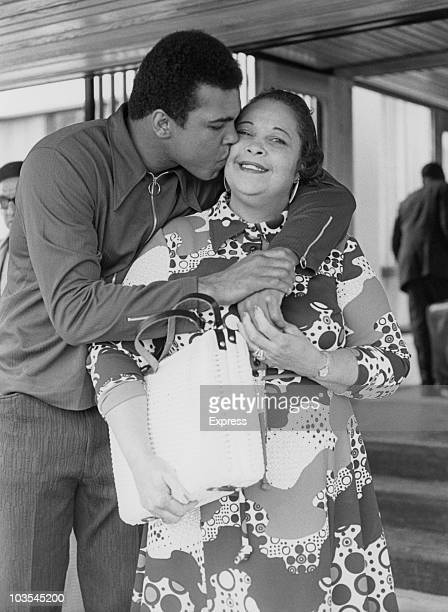 Boxer Cassius Clay pictured hugging and kissing his mother Odessa Lee Clay circa 1965
