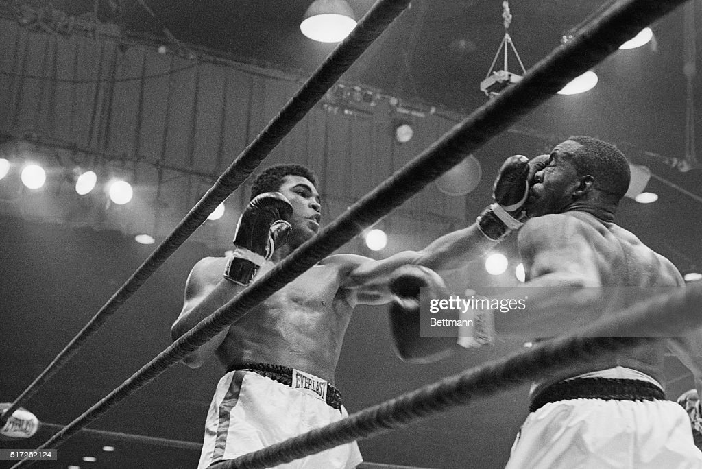 Boxer Cassius Clay punches boxer Sonny Liston in the sixth round during their fight in 1964. Clay, later known as Muhammad Ali, knocked Liston out in the seventh round and became the new heavyweight world champion.