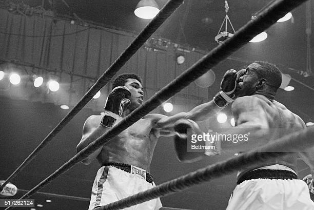 Boxer Cassius Clay punches boxer Sonny Liston in the sixth round during their fight in 1964. Clay, later known as Muhammad Ali, knocked Liston out in...