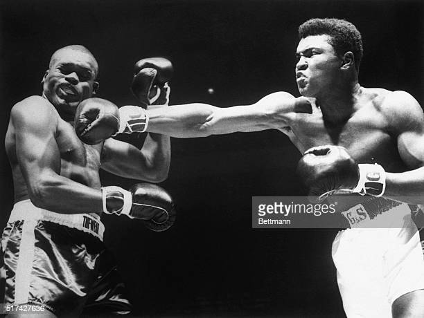 Boxer Cassius Clay punching the head of Doug Jones in the first round of their heavyweight contenders' fight at Madison Square Garden on March 13,...