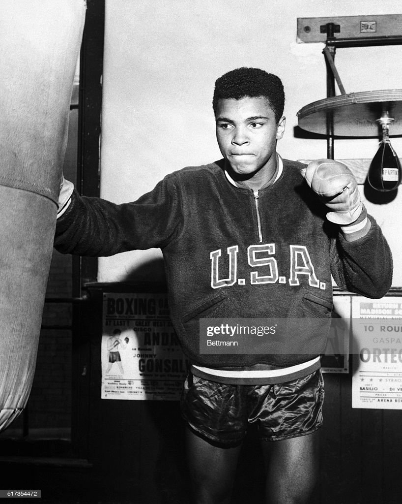 Boxer Cassius Clay (later Muhammad Ali) trains with a punching bag for the 1960 Olympic Games.