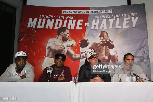 Boxer Charles Hatley of the USA and his father and trainer Greg Hatley listen to Australian boxer Anthony Mundine speaking next to promoter Brian...