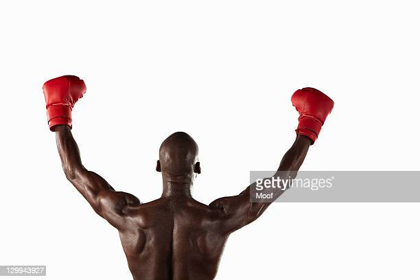 Boxer cheering with fists in air