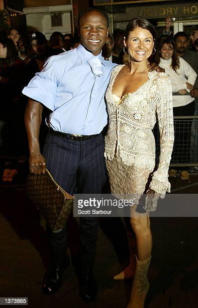 Boxer Chris Eubank and an unidentified woman arrive to the Twin Towers celebrity party held at Red Cube September 8 2002 in London United Kingdom The...