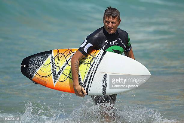 Boxer Danny Green exits the water after competeing in the celebrity challenge during the Boost Mobile Surfsho at Bondi Beach on March 12 2011 in...