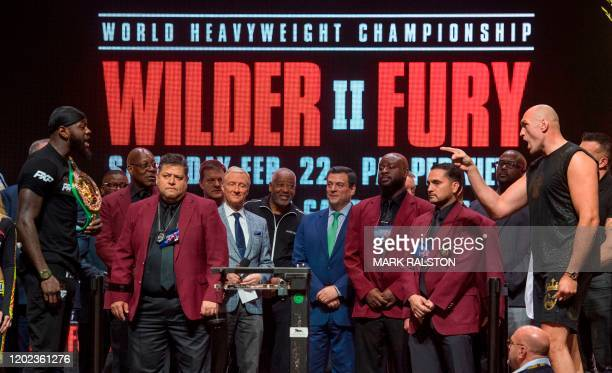 US boxer Deontay Wilder and British boxer Tyson Fury face off during their official weighin at the MGM Grand Las Vegas in Las Vegas Nevada on...