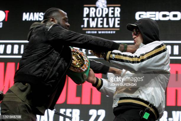 TOPSHOT US boxer Deontay Wilder and British boxer Tyson Fury get into an altercation during their press conference February 19 2020 at the MGM Grand...