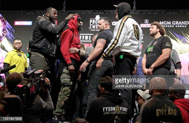 US boxer Deontay Wilder and British boxer Tyson Fury get into an altercation during their press conference February 19 2020 at the MGM Grand Las...