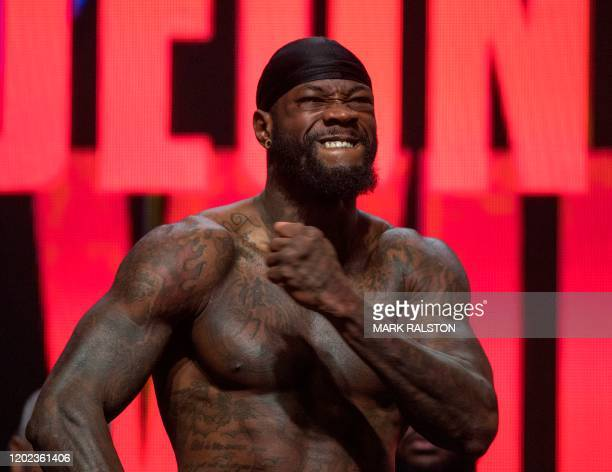 US boxer Deontay Wilder reacts during his official weighin before his heavyweight boxing fight against British boxer Tyson Fury at the MGM Grand Las...