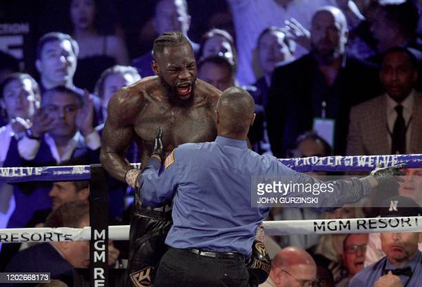 US boxer Deontay Wilder reacts during his World Boxing Council Heavyweight Championship Title boxing match against British boxer Tyson Fury at the...