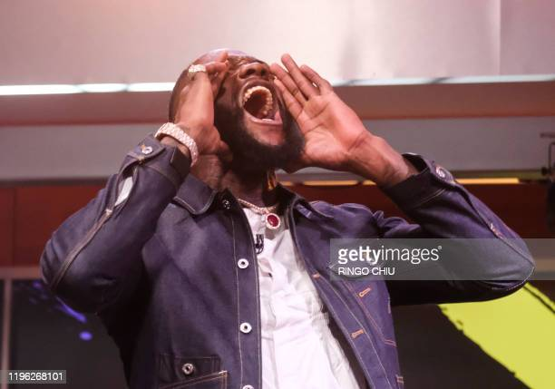 Boxer Deontay Wilder yells during a press conference with Tyson Fury in Los Angeles California on January 25 2020 ahead of their rematch fight in Las...