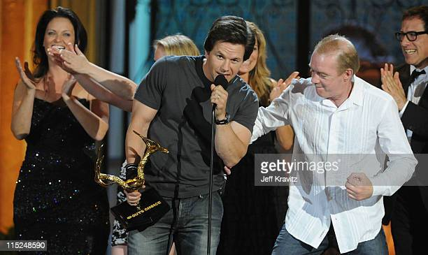 Boxer Dicky Eklund punches Mark Wahlberg onstage during Spike TV's 5th annual 2011 Guys Choice Awards at Sony Pictures Studios on June 4 2011 in...