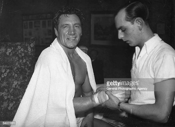 Boxer Eddie Phillips having his hands bandaged while in training at Windsor for his Heavyweight title fight against Len Harvey which he lost on points