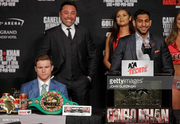 Boxer England's Amir Khan speaks as Saul 'Canelo' Alvarez from Mexico looks on during their final press conference at the MGM Grand in Las Vegas...