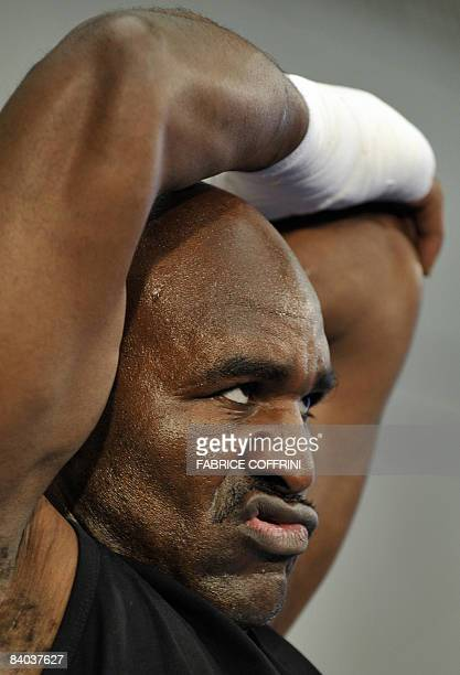 US boxer Evander Holyfield stretches during a public training on December 15 2008 in Zurich ahead of his fight against World Boxing Association...