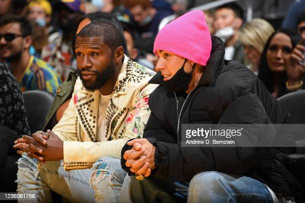 Boxer, Floyd Mayweather and Singer, Justin Bieber attends the Phoenix Suns game against the Los Angeles Lakers on October 22, 2021 at STAPLES Center...
