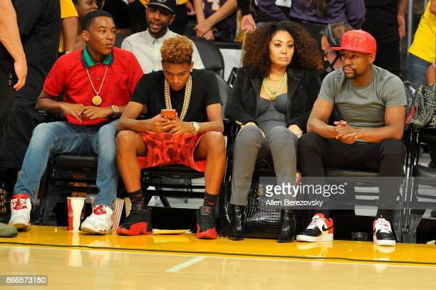 Boxer Floyd Mayweather Jr and his kids Zion Mayweather and Koraun Mayweather attend a basketball game between the Los Angeles Lakers and the...
