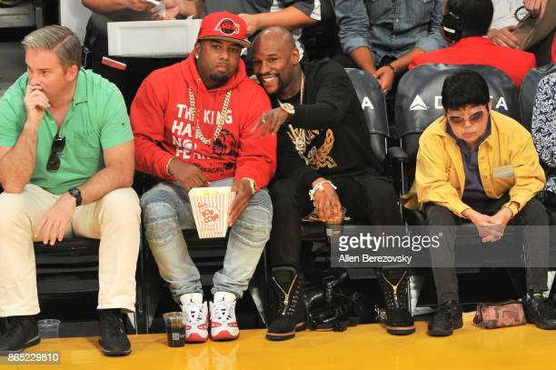 Boxer Floyd Mayweather Jr and James McNair CEO TMT Music Group attend a basketball game between the Los Angeles Lakers and the New Orleans Pelicans...