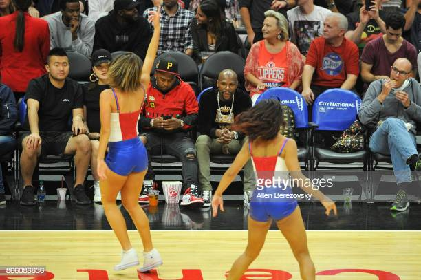 Boxer Floyd Mayweather Jr and James McNair CEO TMT Music Group attend a basketball game between the Los Angeles Clippers and the Utah Jazz at Staples...