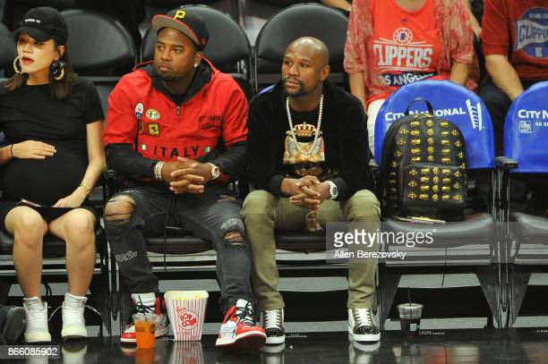 Boxer Floyd Mayweather Jr and James McNair CEO TMT Music Groupattends a basketball game between the Los Angeles Clippers and the Utah Jazz at Staples...