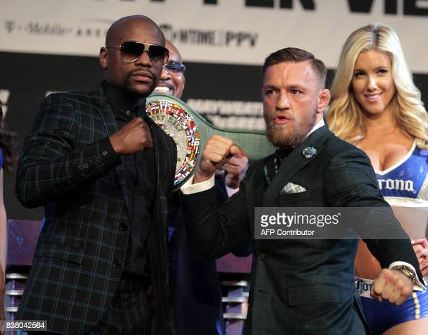 TOPSHOT Boxer Floyd Mayweather Jr and MMA figher Connor Mcgregor pose during a media press conference August 23 2017 at the MGM Grand in Las Vegas...
