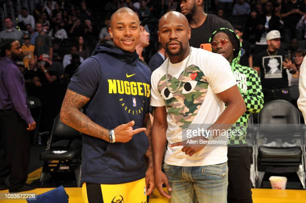 Boxer Floyd Mayweather Jr and NBA player Isaiah Thomas attend a basketball game between the Los Angeles Lakers and the Denver Nuggets at Staples...
