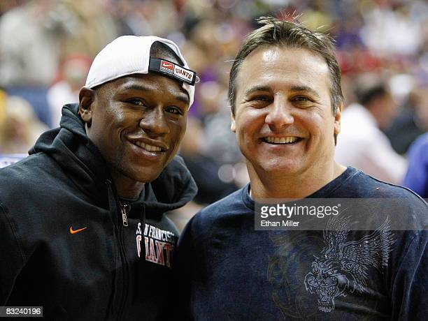 Boxer Floyd Mayweather Jr and Sacramento Kings coowner Gavin Maloof pose at halftime of the Kings preseason game against the Los Angeles Lakers at...