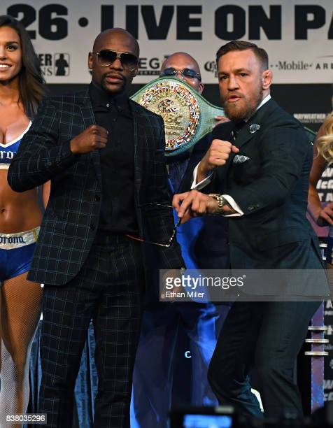 Boxer Floyd Mayweather Jr and UFC lightweight champion Conor McGregor pose during a news conference at the KA Theatre at MGM Grand Hotel Casino on...