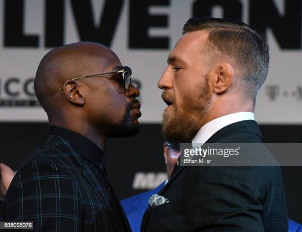 Boxer Floyd Mayweather Jr and UFC lightweight champion Conor McGregor face off during a news conference at the KA Theatre at MGM Grand Hotel Casino...