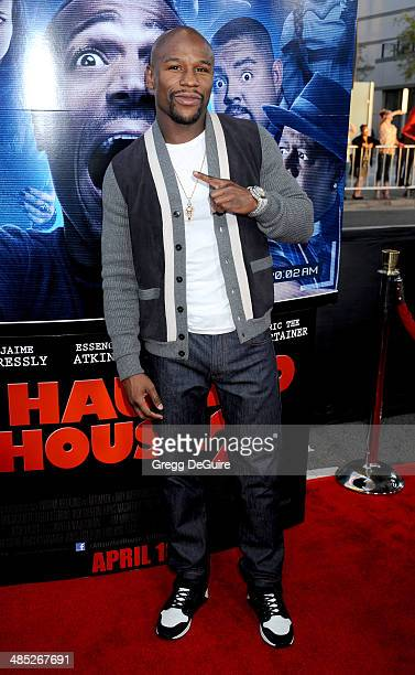 Boxer Floyd Mayweather Jr arrives at the Los Angeles premiere of 'A Haunted House 2' at Regal Cinemas LA Live on April 16 2014 in Los Angeles...